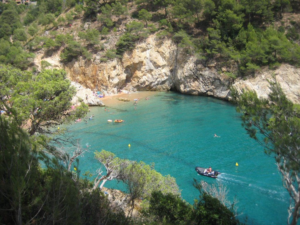 A beautiful view of Cala Pola: a rounded cave with crystaline water above